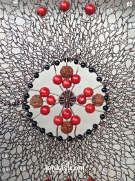 Centre detail- twining with red beads and rudraksha seeds